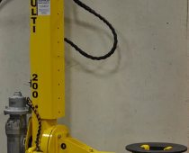Manipulator Arm Lifts Tire Bladder Rings